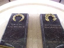 """Two black granite slabs inscribed with the names """"Douglas MacArthur"""" and """"Jean Faircloth MacArthur"""""""
