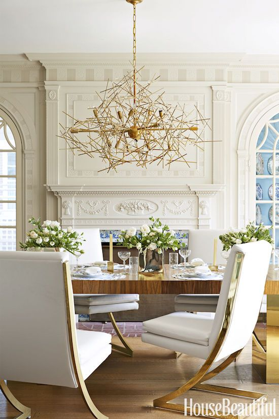 modern brass chairs mixed with traditional architecture