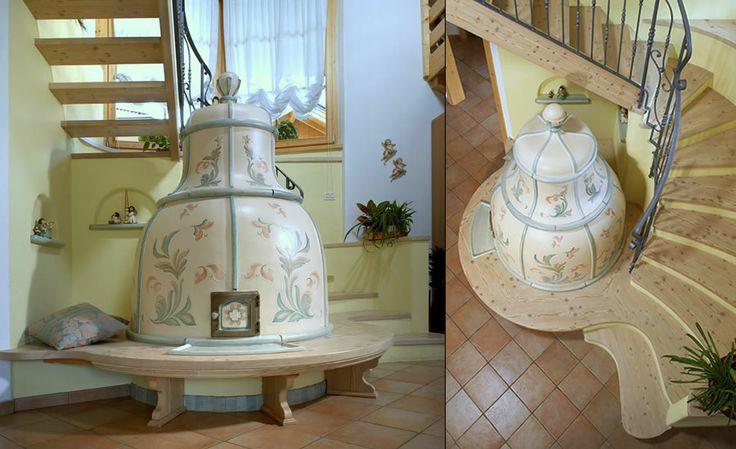 """STUFA A OLE A CAMPANA Stufa in maiolica unica nella sua forma. La stufa a legna ecologica che si distingue per l'unicità delle singole """"ole"""" che la compongono. #stufecollizzolli #handmade #fattoamano #madeinitaly #artigianato #design #italy #arte #qualita #home #casa #arredamento #processoartigianale #ceramica #maiolica #argilla #cotturainforno #pittura #incisioni #rilievi #decorazioni #trentino"""