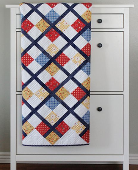 Are you looking for a classy and quick quilt pattern? Try sewing this Preppy Patchy Argyle Quilt that will look lovely in your home!