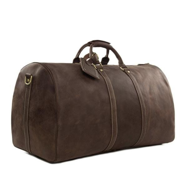 """This amazing vintage leather duffle bag is made of selected top quality genuine leather which gives it a unique rustic look. It has a very large capacity for everything you need for your vacation, including separate compartments for a 20"""" laptop, cell phone, wallet and more, to keep all your belongings right where they should be. This bag comes with a detachable and adjustable shoulder strap for easy carry with style."""