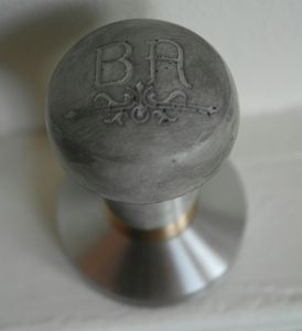 Concrete & brass handmade coffee tamper.  I would never want to drop that on my toe at work.