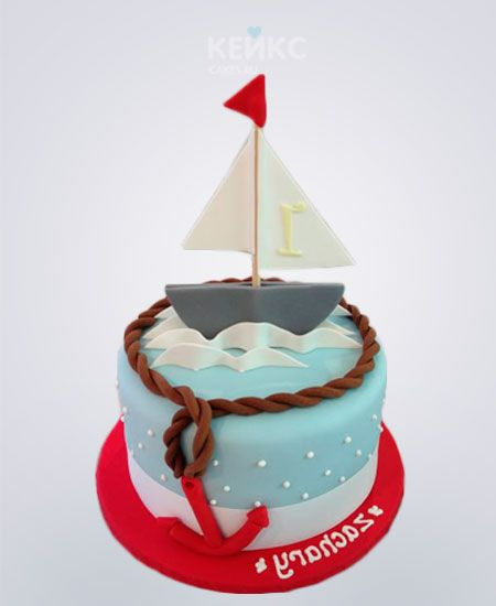 Бело-голубой торт с корабликом и якорем в морском стиле