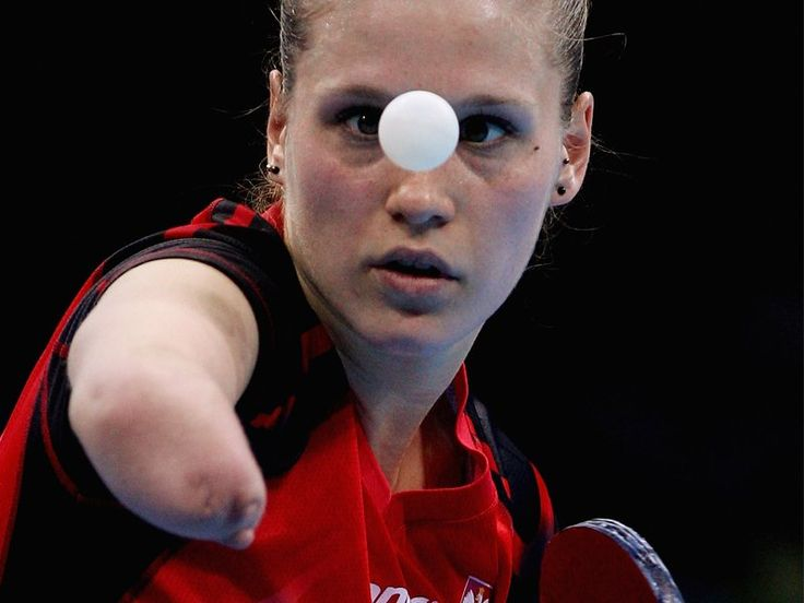 NATALIA PARTYKA One-Handed Poland Olympic Table Tennis Player. Amazing player & awesome pic!