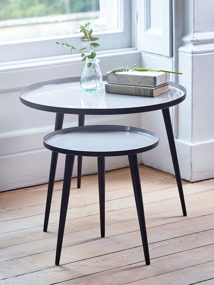 With three simple tapered black legs and a smooth enamelled top, our two metal tables are finished in a dusty mushroom colour. Whether brought alone for beside your bed or next to the sofa, these contemporary tables nest together to make the perfect statement pair.