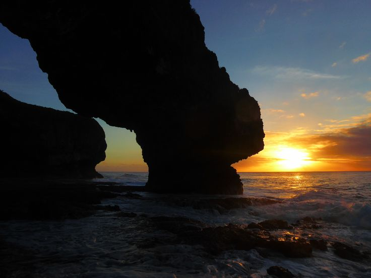 A sinking sun viewed from under Talava Arches in Niue
