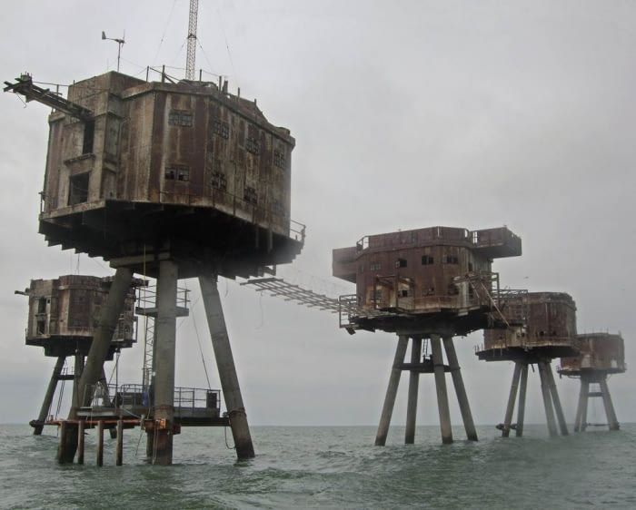 These are Maunsell Sea Forts, used by the British during WW2 to deter enemy air raids. Although abandoned, many of them still stand today.