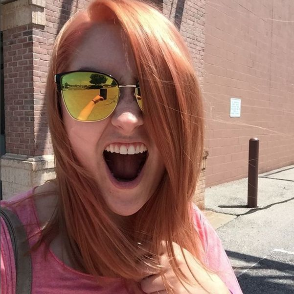 Caitlin's sunny rose-gold hair screams summer! James created this natural looking copper with our Aloxxi International color line. (Redhead, apricot hair color, red hair, orange hair)