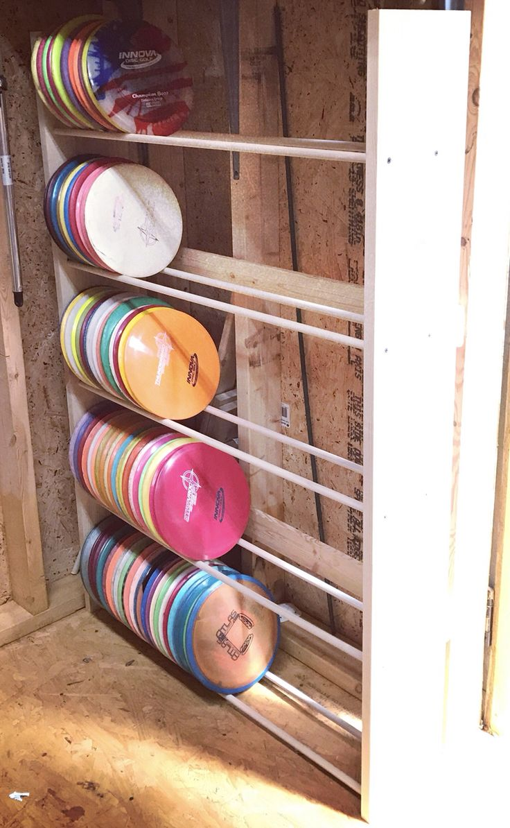 I made this custom disc golf rack for my husband to store his disc collection. It's not quite finished, but it's functional!