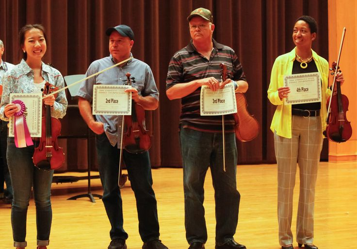 Winners of the 2016 Fiddle Championship. From left: Joanna Calhoun, Grand Champion; Jeffrey Boone, 2nd Place; Ron Pace, 3rd Place; and Jovalyn Johnson, 4th Place (Photo by Peter Jones)
