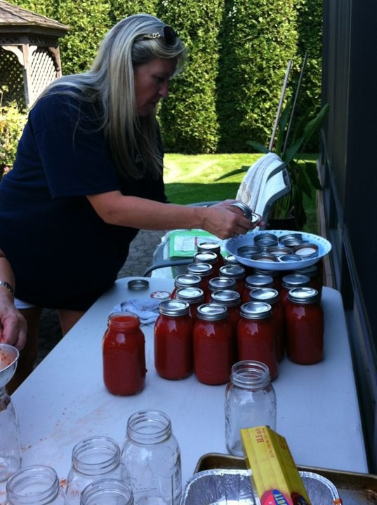 Sauce in jars before they went back into the pot to be boiled again.  This is midway through the process.