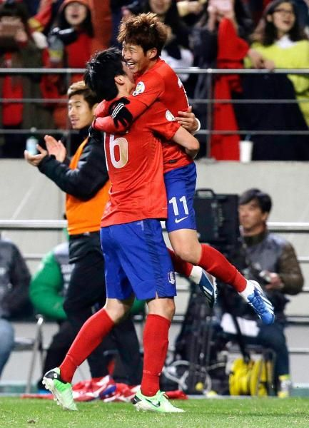 South Korea's Son Heung-min, right, celebrates after scoring a goal with Ki Sung-yueng