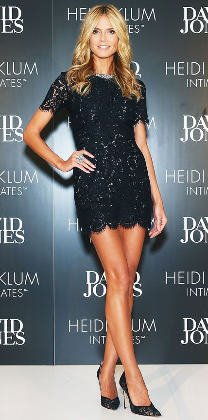 Heidi Klum celebrated the launch of her lingerie line Heidi Klum Intimates in Sydney, Australia in a sexy black lace sequined LBD that she styled a cocktail ring and floral mesh black pumps.