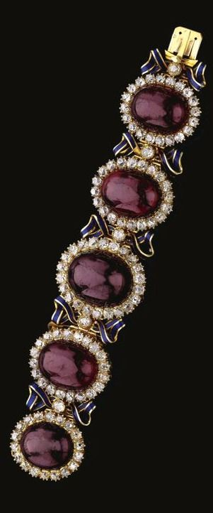 Garnet, Enamel and Diamond Bracelet , mid 19th Century Designed as a series of graduated cabochon garnets, each bordered by circular-cut and cushion-shaped diamonds and spaced by blue enamelled ribbon bow motifs, suspending a detachable heart-shaped pendant, length approximately 155mm, French assay and maker's marks, the reverse of the four smaller cabochon set with blue ribbon and glazed backs. Photo courtesy of Sotheby's