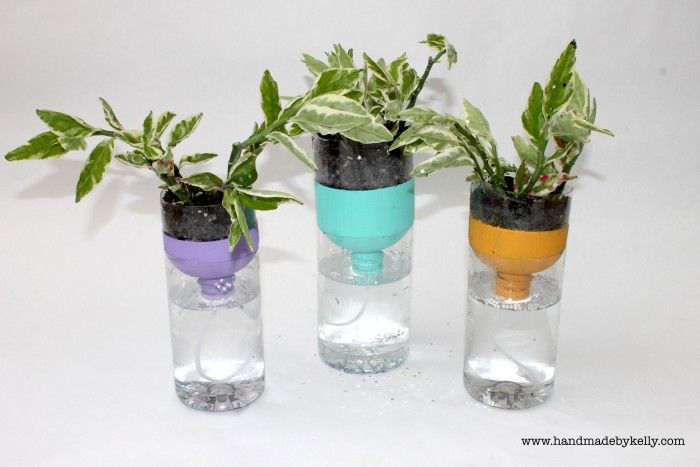 www.handmadebykelly.com Recycled Self Watering Water Bottle Garden Craft for kids and moms