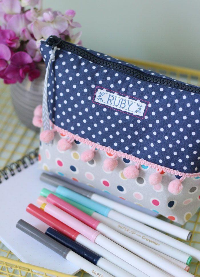 DIY Personalized School Supplies. Love this pom pom pencil case!