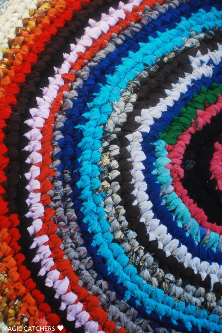 Hand made crochet rug made from scraps of cloth, t-shirts, all upcycled materials. Our favorite blend of colours.