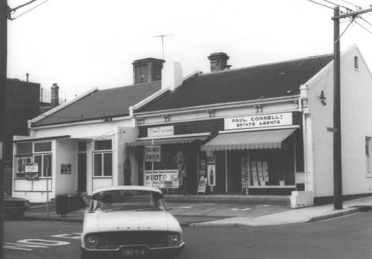 A row of shops on the south side of Greville Street in 1972, between Macquarie Street and St Edmonds Road, including a photographic studio (Mod Color Photography), a milk bar and an estate agents (Paul Connell Pty Ltd). Photo taken by Mardi Cooke.