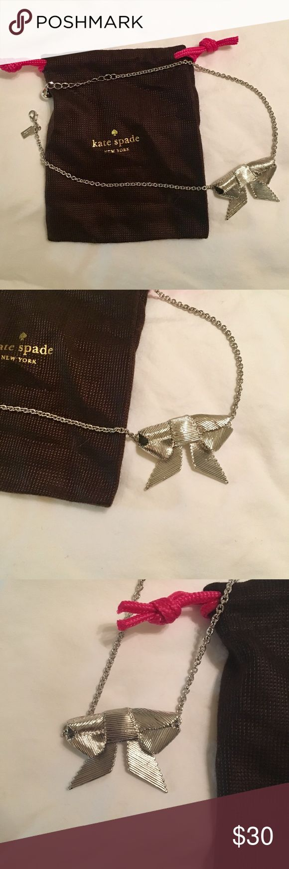 "kate spade ""All Wrapped Up"" silver bow necklace Silver chain and bow pendant from kate spade.   In fantastic condition - worn a couple times.   The jewelry bag pictured will ship with the necklace.  Now is about 2 inches across, chain can be as long as 16 inches. kate spade Jewelry Necklaces"