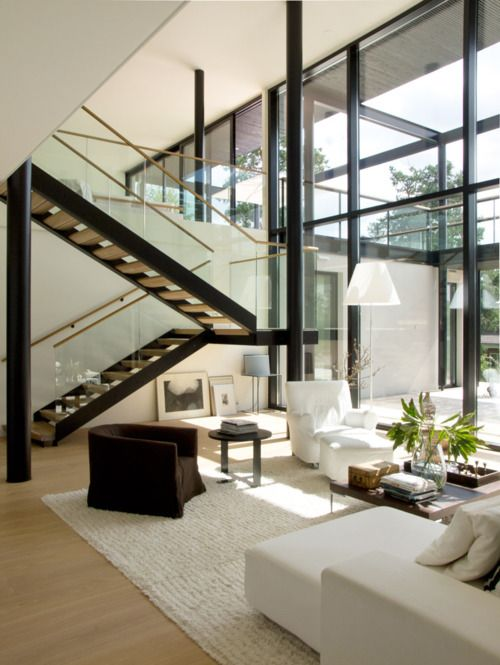Chic Living Room & Amazing Windows with complete wall of windows.