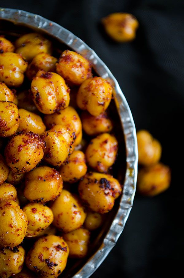 Spicy Crispy Roasted Chickpeas. You can't believe how crispy these are! These are so addictive and easy to make! | giverecipe.com | #chickpeas #snack #appetizer #spicy