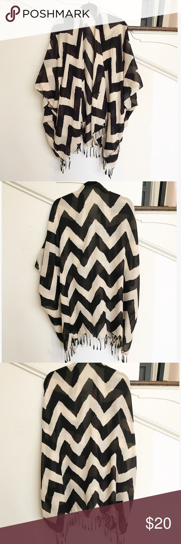 Bcbgeneration Chevron Print Kimono Poncho Jacket BcBGeneration Chevron Poncho. Black and white/cream. Features tassels on the bottom hem. The BcBggenration tag has come off. It was loosely tagged on since you could technically wear it inside or as well. BCBGeneration Jackets & Coats