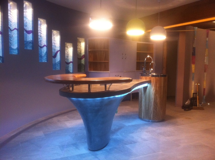 Multi purpose bar in swimming pool made in GRC concrete with olive ash shelf. Scouting shot only