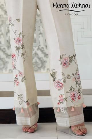 Ivory raw silk boot cut trousers with pink diamante embroidery and embellishment with tassel accessories. Please note these are trousers only. Please note deli