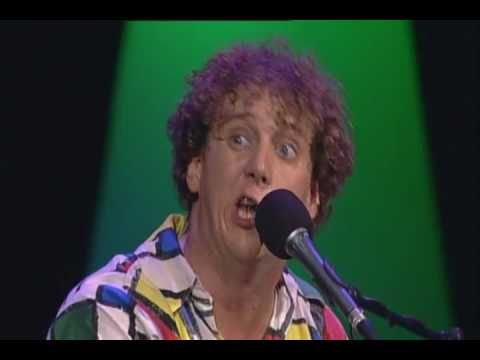 Jochem Myjer (Dutch comedian) Actually is everything from him great. Here he´s singing songs as Dutch Characters.