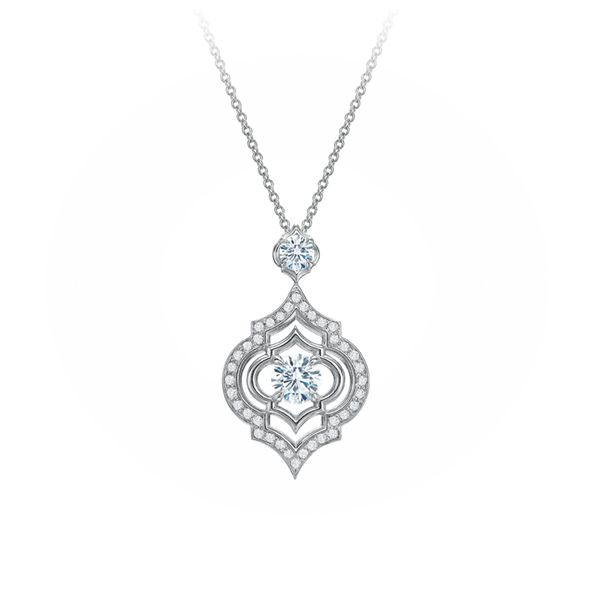 The delicate details of this diamond pendant necklace are divine. Let your bridal style match your regal wedding with ornate, sparkling details.