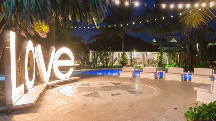 Dance flor over the small pool, lighting love letters and all is set for the wedding party| Venue Kukua Punta Cana| Design Begokua| Photo by Ambrogetty Ameztoy Photography