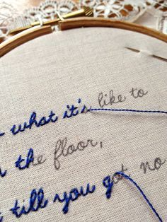 Write song lyrics out, stitch over the words, and use as decoration. I LOVE this idea.