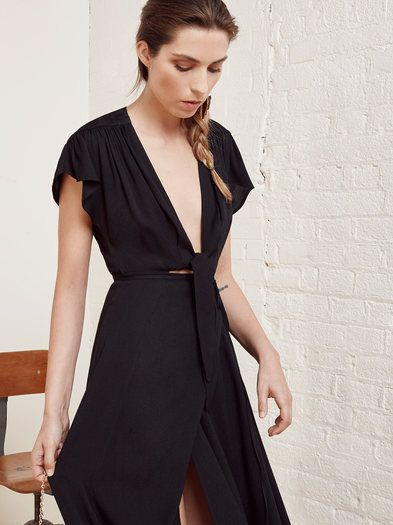 There she is. This is a floor length, wrap dress with a center front tie and cut out.
