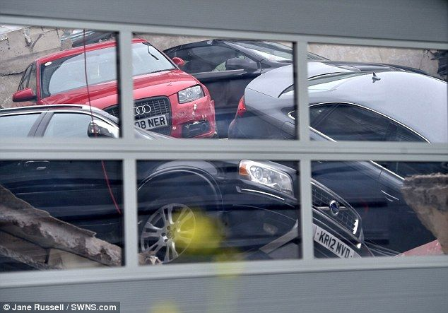 06/01/2015 - 20 cars fall through Milton Keynes Audi dealership first floor onto workshop | Daily Mail Online
