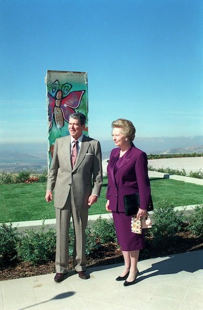 Reagan and Margaret Thatcher with a piece of the Berlin Wall gifted to Reagan's presidential library in Simi Valley, CA.