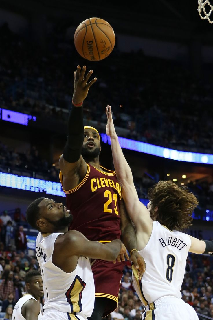 LeBron James #23 of the Cleveland Cavaliers makes a shot over Luke Babbitt #8 of the New Orleans Pelicans at Smoothie King Center on December 12, 2014 in New Orleans, Louisiana.