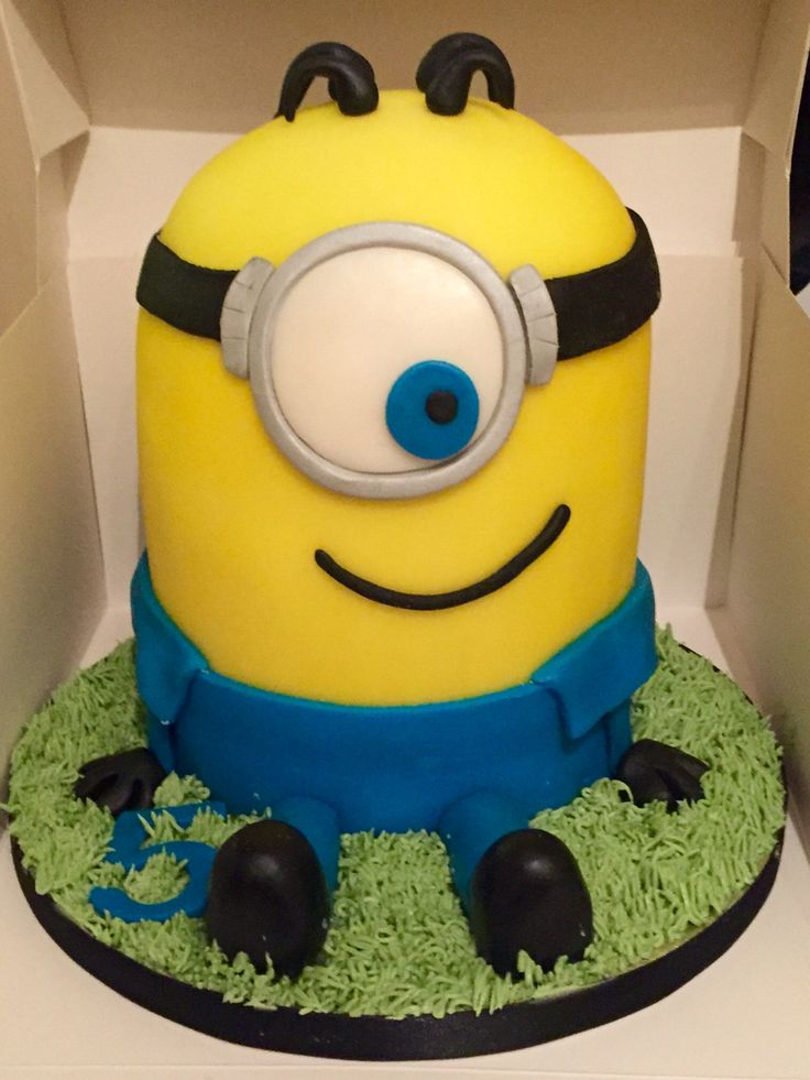 """3D minion birthday cake. 6"""" vanilla cakes stacked with layers of strawberry jam and white chocolate buttercream"""