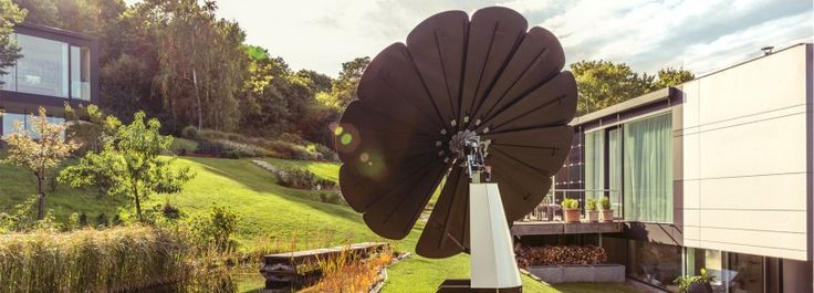 the smartflower POP is a photovoltaic system that takes the form of a flower, with solar panel 'petals' that automatically unfurl when the sun rises.