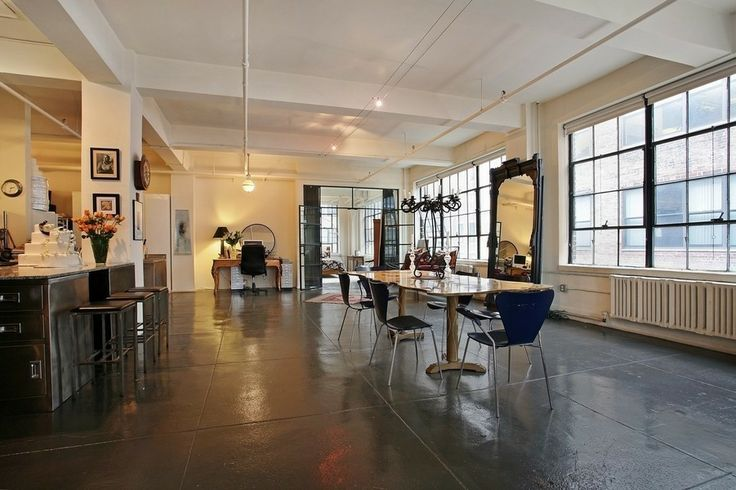New York loft big windows view concrete floor pillars GSM