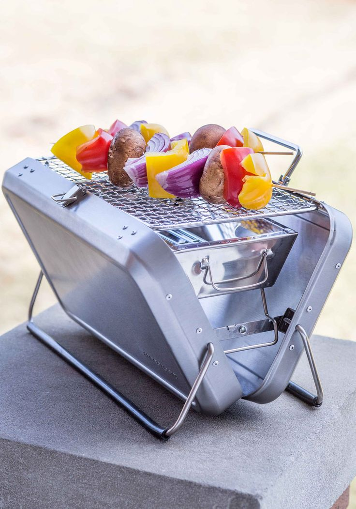 Cookout Crusader Portable Grill. Its a bird, its a plane - its a portable charcoal grill! #silver #modcloth