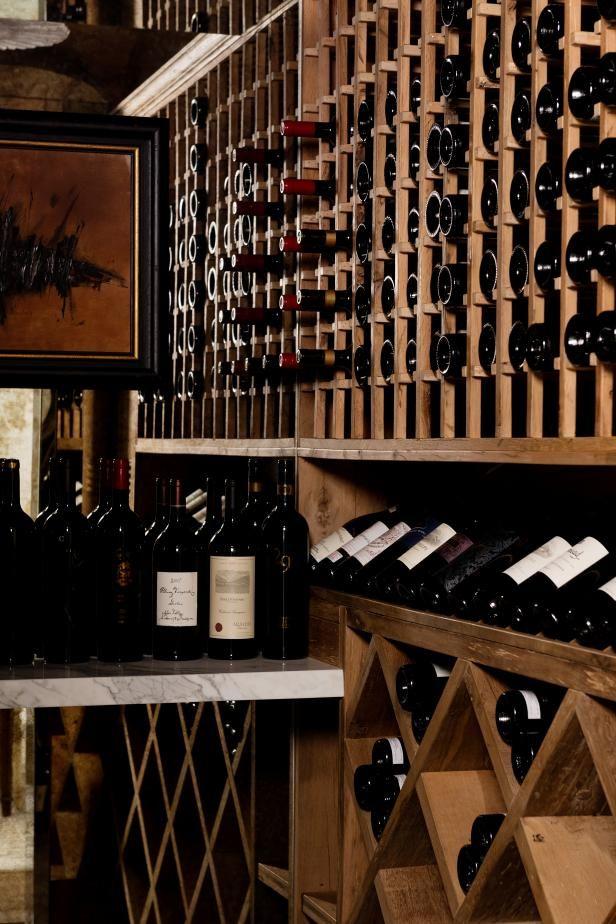 HGTV invites you to peek inside this sophisticated wine cellar with rustic wood wine racks.