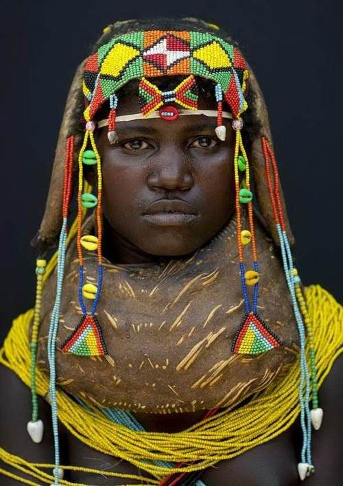 Africa    People.  Young Girl of the Mwila (Mumuhuila or Muhuila) Tribe ~ Angola   Photo by Eric Lafforgue