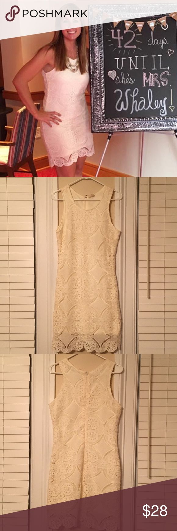 Adorable White Dress! Very cute Ivory dress in great condition! I wore this dress once for a bridal shower and loved it! It does have some slight discoloration near the top of the zipper, it was there when I bought it but didn't concern me because my hair covered the area. See photos. Dresses Mini