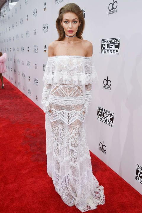 Gigi Hadid looked beautiful in an off the shoulder white lace dress at last night's American Music Awards. See all the best dressed celebrities from the event here: http://www.harpersbazaar.co.uk/fashion/style-files/news/g37392/2016-american-music-awards-red-carpet/