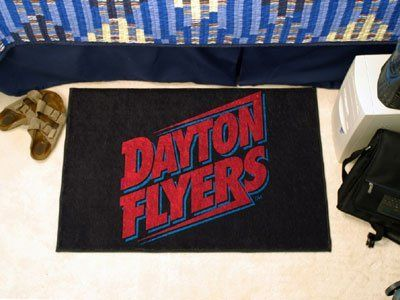 """Dayton Starter Rug 20""""x30"""" by Fanmats. $13.68. Dayton Starter Rug 20""""x30""""Decorate your home or office with area rugs by FANMATS. Made in U.S.A. 100% nylon carpet and non-skid recycled vinyl backing. Officially licensed and chromojet printed in true team colors. Please note: These products are custom made. The normal lead time is about 7-10 business days. However, the putting mats and carpet tiles do take a little longer, about 14-21 business days.***This item i..."""