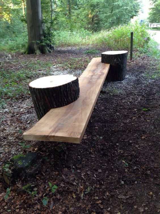 Build your own garden bench. All you need is a couple of tree stumps, a long piece of wood, and a saw to slit the stumps where the wood will fit into them.: