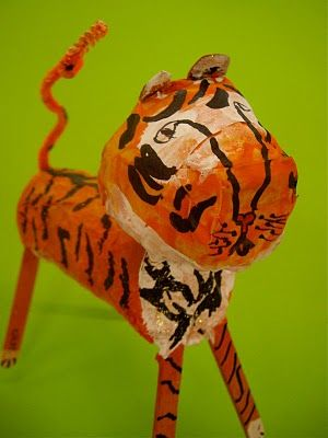 Paper mache. Cardboard tube, egg carton, popcicle sticks, pipe cleaner. I think I could do this with my elementary kids.