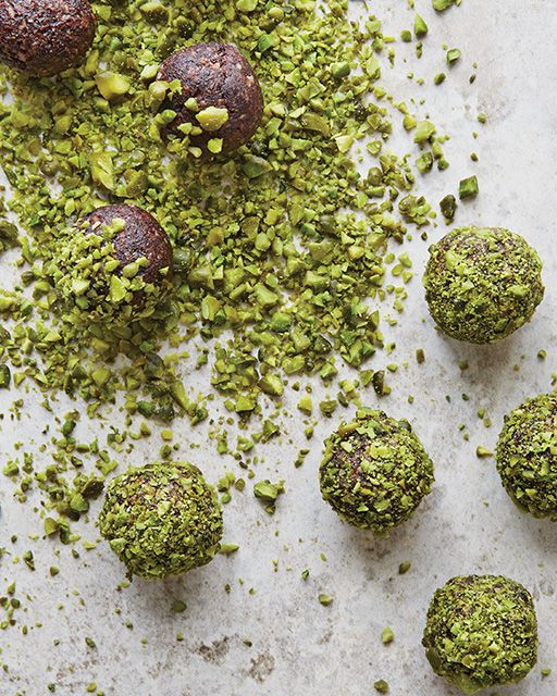 Healthy and delicious date balls with an aromatic taste of cocoa and green crunchiness from the pistachios. No sugar added to these tasty balls—a perfect snack.