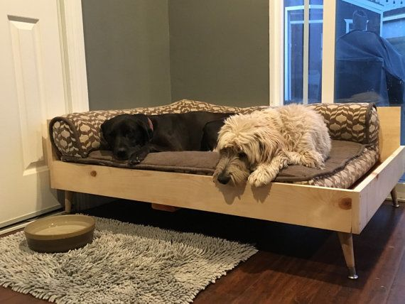 Pictured unstained. Can be stained to a choice of colors or sealed raw. This beautiful mid century modern style dog bed is an excellent way to