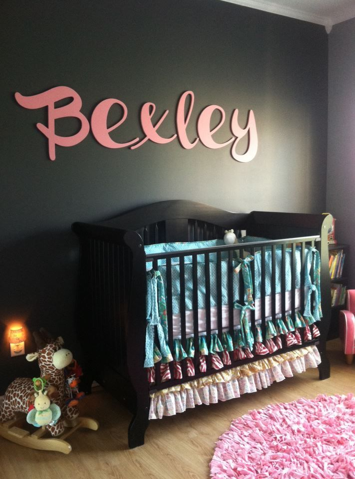 Charcoal gray accent wall with name above crib in wooden letters - #nursery: Idea, Dark Walls, Black Baby Cribs, Modern Nurseries, Baby Rooms, Bright Colors, Plain Wall, Grey Accent Wall, Black Wall